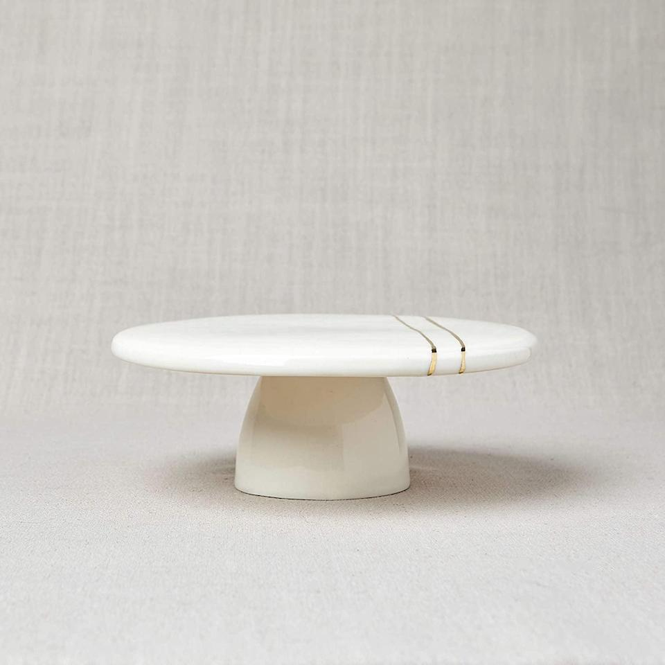 <p>This <span>White and Gold Porcelain Cake Stand</span> ($80) is so gorgeous. You can use it for cake, as decor or as display piece for your fragrances and perfumes.</p>