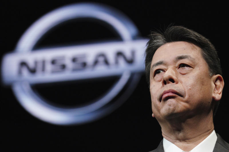 FILE - In this Dec. 2, 2019, file photo, Nissan Chief Executive Makoto Uchida speaks during a press conference in the automaker's headquarters in Yokohama, near Tokyo. Nissan shareholders unleashed their anger at the Japanese automaker's management Tuesday, Feb. 18, 2020, for crashing stock prices, zero dividends and quarterly losses after the scandal-ridden departure of former Chairman Carlos Ghosn. (AP Photo/Eugene Hoshiko, File)