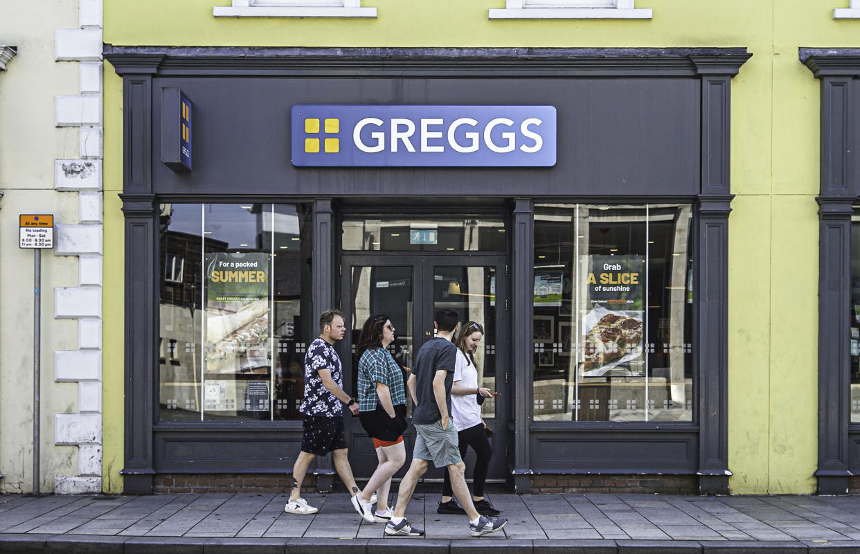 LISBURN, UNITED KINGDOM - 2021/08/06: People walk past Greggs Hot Food Store on Bow Street in Lisburn. (Photo by Michael McNerney/SOPA Images/LightRocket via Getty Images)
