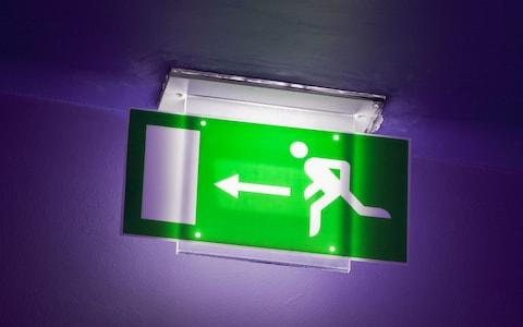 Exit sign - Credit: NICK FIELDING / Alamy Stock Photo