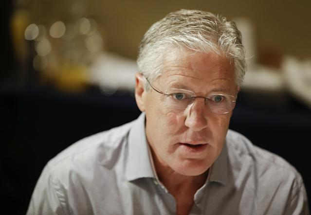 Seattle Seahawks head coach Pete Carroll speaks with reporters during the NFC Head Coaches Breakfast at the NFL football meetings in Orlando, Fla., Wednesday, March 26, 2014. (AP Photo/John Raoux