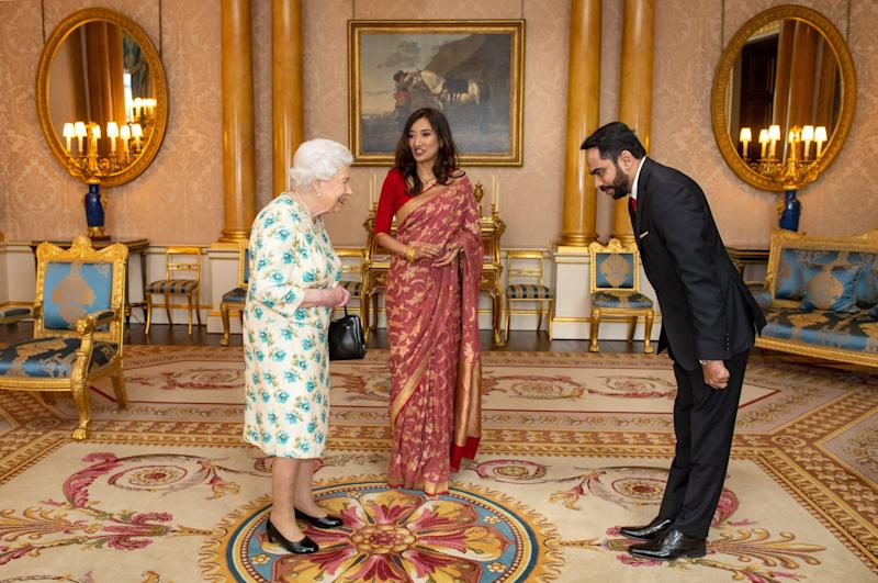 Britain's Queen Elizabeth II meets High Commissioner of Sri Lanka Saroja Sirisena (c) and her husband Sudath Talpahewa (R) during an audience at Buckingham Palace, London on March 10, 2020. (Photo by Dominic Lipinski / POOL / AFP) (Photo by DOMINIC LIPINSKI/POOL/AFP via Getty Images)