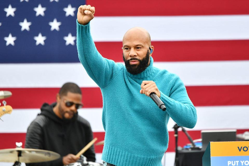 <p>Common takes the stage to perform during the Souls to the Polls drive-in rally for Rev. Raphael Warnock on Sunday at Riverside EpiCenter in Austell, Georgia.</p>