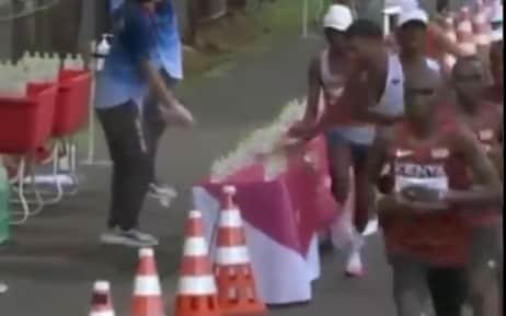 Tokyo 2020 Olympics: French marathon runner Morhad Amdouni knocks over entire row of water bottles - then runs off with last one