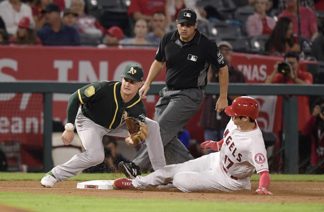 Los Angeles Angels' Shohei Ohtani, right, of Japan, steals third as Oakland Athletics third baseman Matt Chapman takes a late throw from home during the second inning of a baseball game Friday, Sept. 28, 2018, in Anaheim, Calif. (AP Photo/Mark J. Terrill)