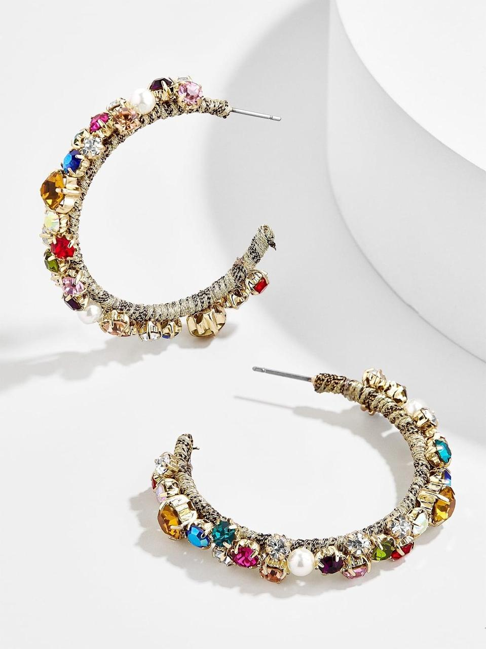 "<p><a href=""https://www.popsugar.com/buy/Elysian-Hoops-570412?p_name=Elysian%20Hoops&retailer=baublebar.com&pid=570412&price=22&evar1=fab%3Aus&evar9=47437458&evar98=https%3A%2F%2Fwww.popsugar.com%2Fphoto-gallery%2F47437458%2Fimage%2F47440730%2FElysian-Hoops&list1=shopping%2Cjewelry%2Caccessories%2Cbaublebar%2Cspring%20fashion%2Csale%20shopping%2Cfashion%20shopping&prop13=api&pdata=1"" class=""link rapid-noclick-resp"" rel=""nofollow noopener"" target=""_blank"" data-ylk=""slk:Elysian Hoops"">Elysian Hoops</a> ($22, originally $40)</p>"