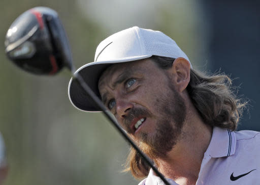 Tommy Fleetwood, of England, watches his tee shot on the 16th hole during the second round of The Players Championship golf tournament Friday, March 15, 2019, in Ponte Vedra Beach, Fla. (AP Photo/Gerald Herbert)