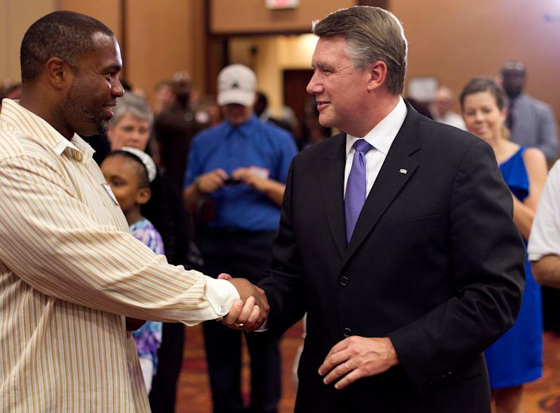 Mark Harris, right, talks with Jahnmaud O. Lane during an election party in Raleigh, North Carolina, on Tuesday.