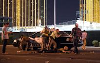 <p>Las Vegas police stand guard along the streets outside the the Route 91 Harvest country music festival grounds after the active shooter was reported. (Photo by David Becker/Getty Images) </p>