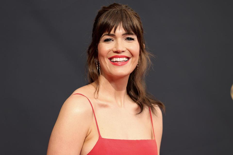 """<p>The <em><a href=""""https://people.com/tag/mandy-moore/"""" rel=""""nofollow noopener"""" target=""""_blank"""" data-ylk=""""slk:This Is Us actress"""" class=""""link rapid-noclick-resp"""">This Is Us actress</a></em> said her <a href=""""https://people.com/parents/2021-emmy-awards-mandy-moore-reveals-new-mom-mvp-accessory/"""" rel=""""nofollow noopener"""" target=""""_blank"""" data-ylk=""""slk:&quot;MVP accessory&quot; was her breast pump"""" class=""""link rapid-noclick-resp"""">""""MVP accessory"""" was her breast pump</a> before wow-ing on the carpet in a bright red lip and """"Audrey Hepburn-inspired"""" hairstyle. Hairstylist <a href=""""https://www.instagram.com/streicherhair/?hl=en"""" rel=""""nofollow noopener"""" target=""""_blank"""" data-ylk=""""slk:Ashley Streicher"""" class=""""link rapid-noclick-resp"""">Ashley Streicher</a> had a trio of Garnier sprays on deck to perfect the look: <a href=""""https://protect-us.mimecast.com/s/W-mcCL9G9WFPrgPA5Cgv665?domain=garnierusa.com"""" rel=""""nofollow noopener"""" target=""""_blank"""" data-ylk=""""slk:Texture Tease Dry Touch Finishing Spray"""" class=""""link rapid-noclick-resp"""">Texture Tease Dry Touch Finishing Spray</a>, <a href=""""https://protect-us.mimecast.com/s/py4MCM8X8WF51L5gGCGnAjE?domain=garnierusa.com"""" rel=""""nofollow noopener"""" target=""""_blank"""" data-ylk=""""slk:Style Flexible Control Hairspray"""" class=""""link rapid-noclick-resp"""">Style Flexible Control Hairspray </a>and <a href=""""https://protect-us.mimecast.com/s/tX31CPNGNWu4R24OqIWCvrF?domain=garnierusa.com"""" rel=""""nofollow noopener"""" target=""""_blank"""" data-ylk=""""slk:Style Flat Iron Perfector Straightening Mist"""" class=""""link rapid-noclick-resp"""">Style Flat Iron Perfector Straightening Mist</a>. Meanwhile a few passes of the <a href=""""https://www.ulta.com/p/lucea-1-professional-straightening-styling-flat-iron-pimprod2016016"""" rel=""""nofollow noopener"""" target=""""_blank"""" data-ylk=""""slk:T3 Lucea Flat Iron"""" class=""""link rapid-noclick-resp"""">T3 Lucea Flat Iron</a> gave her faux bangs a believable bounce.</p>"""