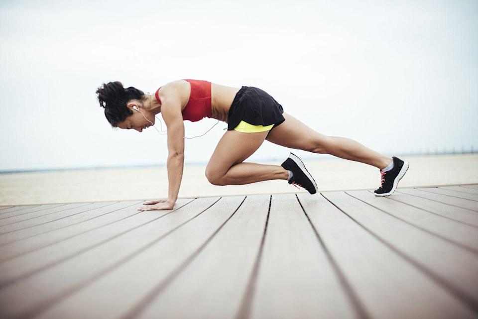 <p>Like burpees, Michaels is a fan of this moving plank exercise because it works your core, in addition to a slew of other body muscles.</p><p><strong>How to do mountain climbers: </strong>Get into a high-plank position with your wrists directly under your shoulders. Keep your core tight, drawing your belly button in toward your spine. Drive your right knee toward your chest and then bring it back to plank. Then, drive your left knee toward your chest and bring it back. Continue to alternate sides.</p>