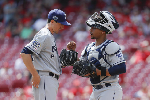 San Diego Padres' relief pitcher Eric Yardley, left, making his major league debut, talks with catcher Francisco Mejia in the third inning of a baseball game, Wednesday, Aug. 21, 2019, in Cincinnati. (AP Photo/John Minchillo)