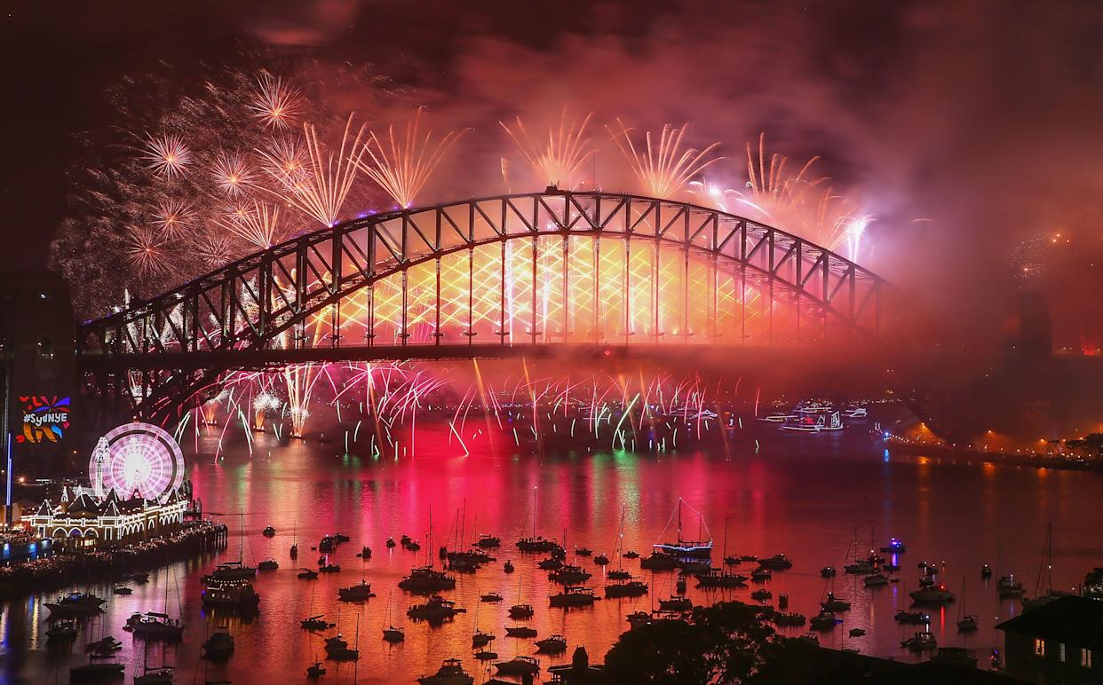 Fireworks explode from the Sydney Harbour Bridge and the Sydney Opera House during the midnight fireworks display on New Year's Eve on January 1, 2018 in Sydney, Australia. (Photo: Scott Barbour\City of Sydney via Getty Images)