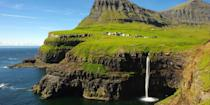 """<p>One of the world's most remote places is also one of its most beautiful. In the Faroe Islands — an off-the-beaten-path, 18-island volcanic chain in the North Atlantic — you'll be gobsmacked by scenery that includes <a href=""""https://www.tripadvisor.com/Attraction_Review-g1510677-d9564432-Reviews-Mulafossur_Waterfall-Vagar_Island.html"""" rel=""""nofollow noopener"""" target=""""_blank"""" data-ylk=""""slk:Mulafossur Waterfall"""" class=""""link rapid-noclick-resp"""">Mulafossur Waterfall</a> and the <a href=""""https://www.tripadvisor.com/Attraction_Review-g190336-d14890702-Reviews-Vestmanna_Bird_Cliffs-Vestmanna_Streymoy.html"""" rel=""""nofollow noopener"""" target=""""_blank"""" data-ylk=""""slk:Vestmanna Bird Cliffs"""" class=""""link rapid-noclick-resp"""">Vestmanna Bird Cliffs</a>. Plus, there are puffin breeding grounds, lighthouses, grass-roofed houses, and chances to spot the elusive <a href=""""https://www.bestproducts.com/fun-things-to-do/a25906883/where-to-see-northern-lights/"""" rel=""""nofollow noopener"""" target=""""_blank"""" data-ylk=""""slk:Northern Lights"""" class=""""link rapid-noclick-resp"""">Northern Lights</a>!</p><p><strong>More: </strong><a href=""""https://www.bestproducts.com/fun-things-to-do/g2550/best-countries-and-places-to-live-in/"""" rel=""""nofollow noopener"""" target=""""_blank"""" data-ylk=""""slk:What's the Best Country in the World to Live In? Read our List!"""" class=""""link rapid-noclick-resp"""">What's the Best Country in the World to Live In? Read our List!</a></p>"""