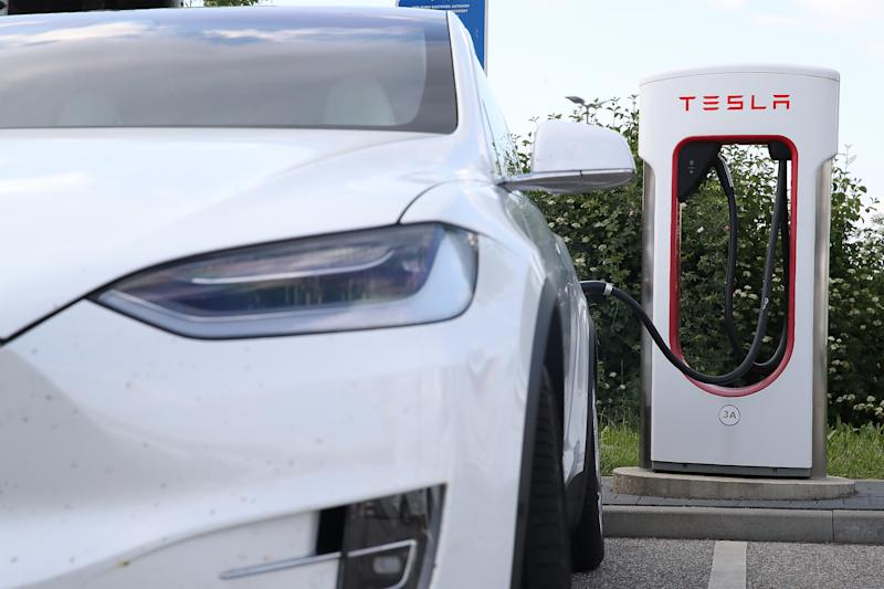 SCHWEITENKIRCHEN, GERMANY - MAY 26: Tesla cars charge at Tesla Superchargers at a rest stop on the A9 highway on May 26, 2020 at Schweitenkirchen, Germany. Tesla has expanded its network of Supercharger stations in Germany to 73 with another four currently under construction. (Photo by Alexander Hassenstein/Getty Images)