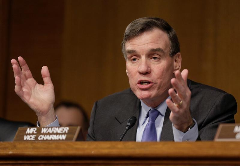 """File Photo: Senator Mark Warner (D-VA) questions witnesses during a Senate Select Committee on Intelligence hearing on """"Russia's intelligence activities"""" on Capitol Hill in Washington"""