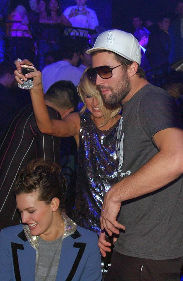 """The hotel heiress also got cozy with her pal Brody Jenner. Will hanging out with Paris help Brody get over his breakup with Lauren Conrad? Probably not. Eric Boone/<a href=""""http://www.splashnewsonline.com"""" target=""""new"""">Splash News</a> - December 31, 2007"""