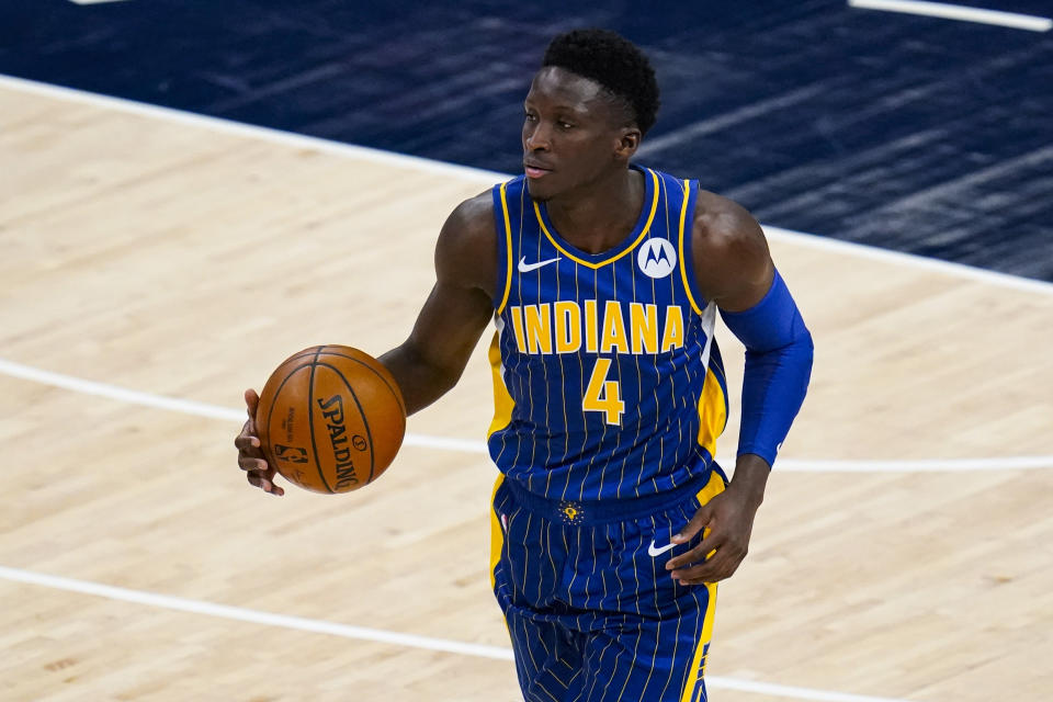 Indiana Pacers guard Victor Oladipo (4) plays against the Cleveland Cavaliers during the first half of an NBA basketball game in Indianapolis, Thursday, Dec. 31, 2020. (AP Photo/Michael Conroy)