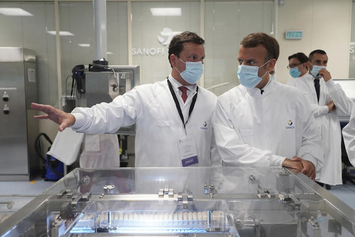 French President Emmanuel Macron visits a Sanofi plant in France in June.