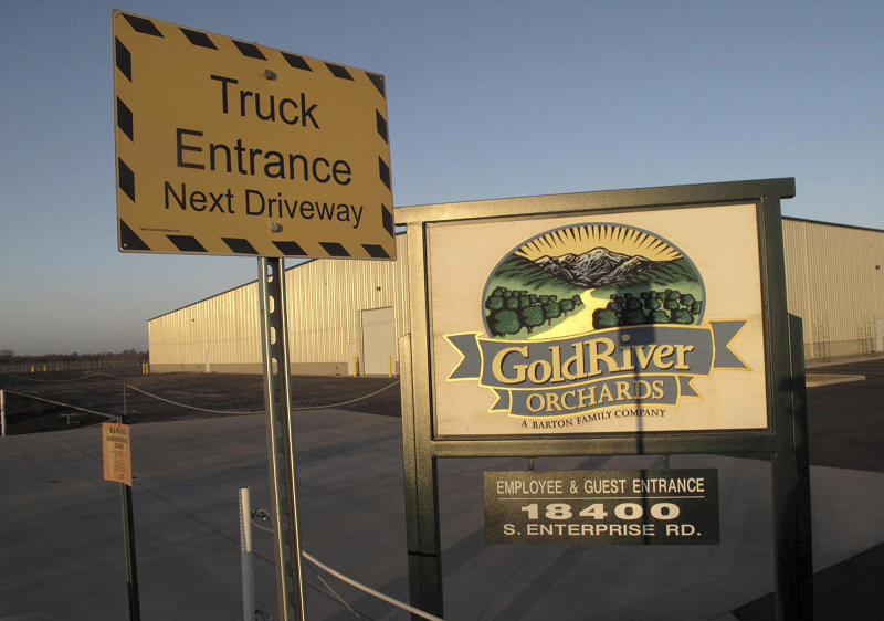 This Thursday, Jan. 16, 2014 photo shows the outside of GoldRiver Orchards, a walnut grower and processor, in Escalon, Calif. The company fell victim in October 2013 to a brazen heist when thieves made off with 140,000 pounds of processed walnuts worth $400,000. Thieves cut through wooden fence posts in the dead of night, hooked up a truck to gondola trailers brimming with nuts and drove off. (AP Photo/Scott Smith)