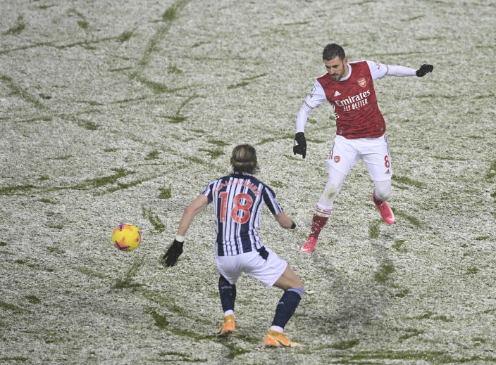 West Bromwich Albion's Conor Gallagher, left and Arsenal's Dani Ceballos vie for the ball with during the English Premier League soccer match between West Bromwich Albion and Arsenal at the Hawthorns in Birmingham, England, Saturday, Jan. 2, 2021. (Michael Regan/ Pool via AP)