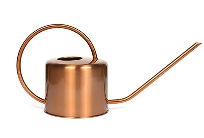 """Find this Homarden Copper Colored Watering Can for $30 on <a href=""""https://amzn.to/3fefSK9"""" rel=""""nofollow noopener"""" target=""""_blank"""" data-ylk=""""slk:Amazon"""" class=""""link rapid-noclick-resp"""">Amazon</a>."""