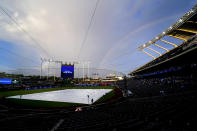 A rainbow rises beyond right field of Kauffman Stadium during a rain delay in the second inning of a baseball game between the Kansas City Royals and the Milwaukee Brewers Tuesday, May 18, 2021, in Kansas City, Mo. (AP Photo/Charlie Riedel)