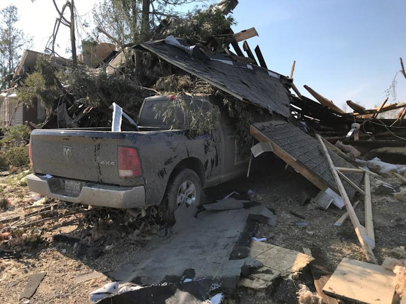 A truck is covered in debris after a tornado tore through Dunrobin, Ont. on Sept. 21, 2018.