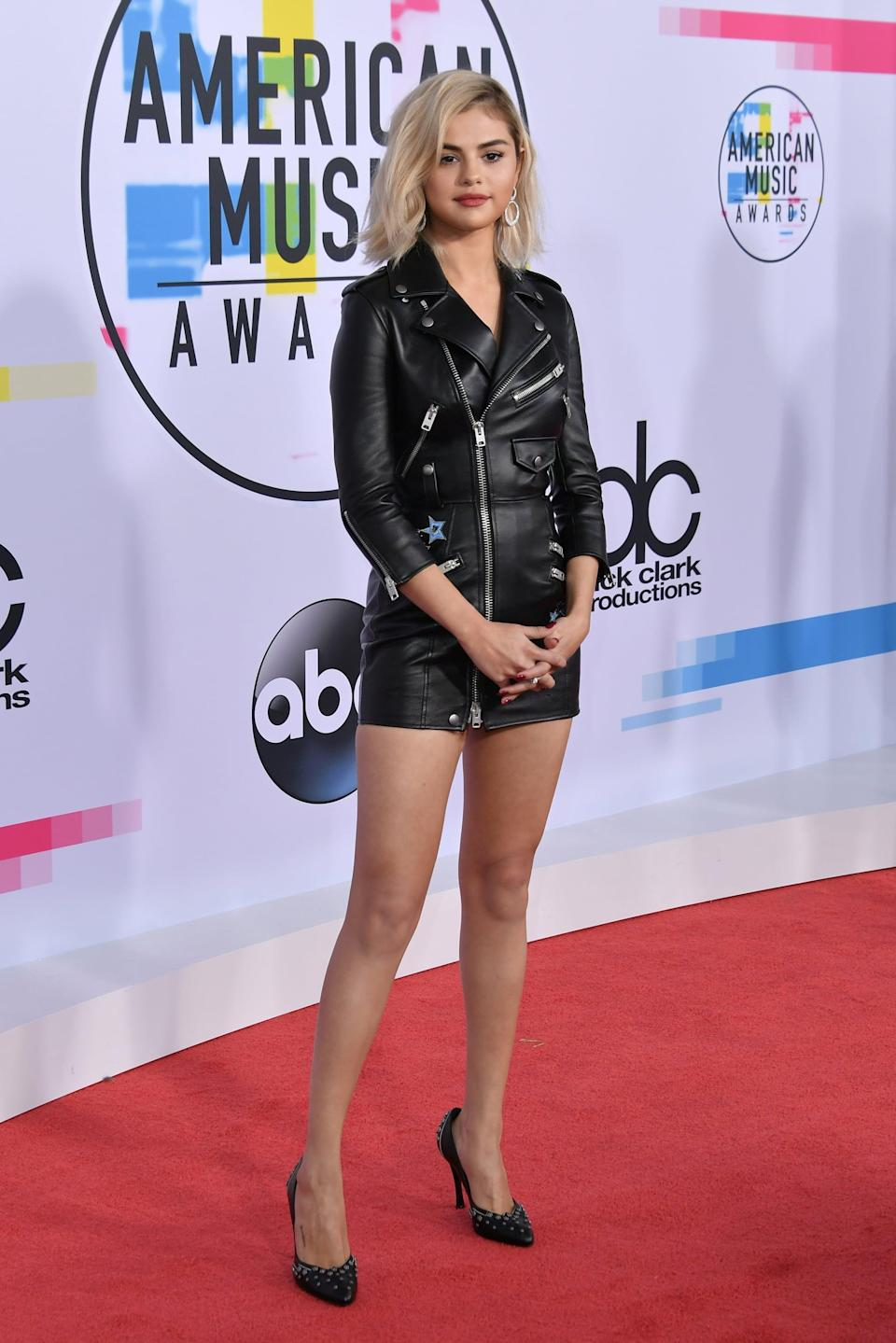 """<p>Yep, the black leather heels Selena wore with <a href=""""https://www.popsugar.com/fashion/Selena-Gomez-Coach-Dress-American-Music-Awards-2017-44278054"""" class=""""link rapid-noclick-resp"""" rel=""""nofollow noopener"""" target=""""_blank"""" data-ylk=""""slk:her moto-effect Coach dress"""">her moto-effect Coach dress</a> at the 2017 American Music Awards in LA were complete with miniature flower studs. You've got to zoom in to get a good look at these puppies, which are also by Coach.</p>"""