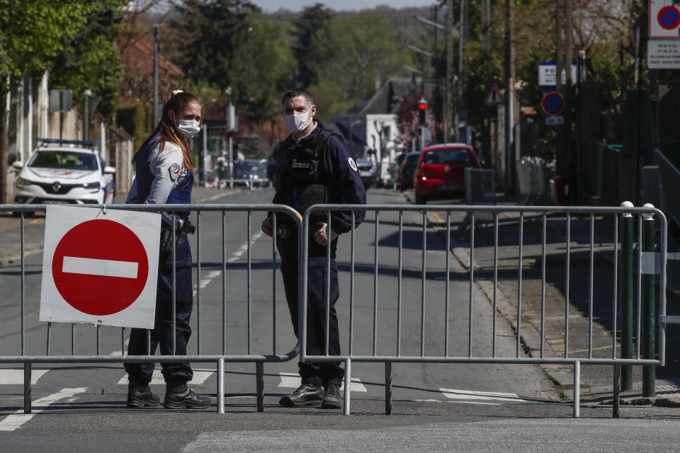 French police officers block the access next to the police station where a police official was stabbed to death Friday in Rambouillet, south west of Paris, Saturday, April 24, 2021. Anti-terrorism Investigators were questioning three people Saturday detained after the deadly knife attack a day earlier on a police official at the entry to her station in the quiet town of Rambouillet, seeking a motive, purported ties to a terrorist group and whether the attacker, killed by police, acted alone. (AP Photo/Michel Euler)