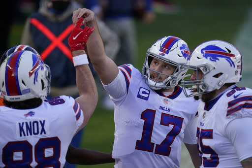 Buffalo Bills quarterback Josh Allen (17) celebrates with tight end Dawson Knox, left, after a touchdown during the first half of an NFL football game against the Denver Broncos, Saturday, Dec. 19, 2020, in Denver. (AP Photo/Jack Dempsey)
