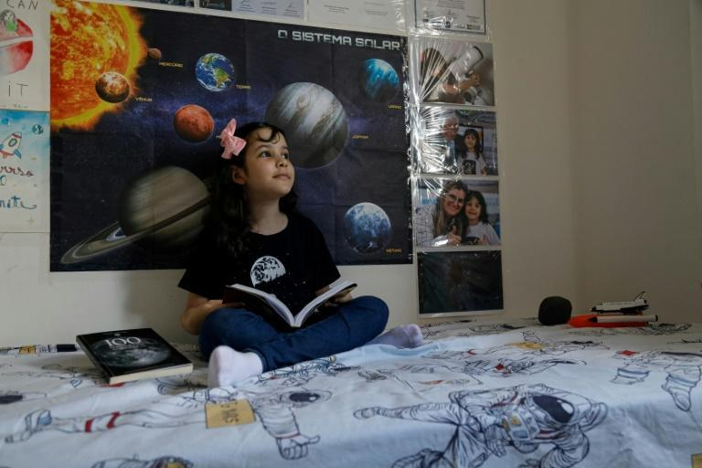 Eight-year-old Nicole Oliveira, known as Nicolinha, has been dubbed the world's youngest astronomer (AFP/Jarbas Oliveira)