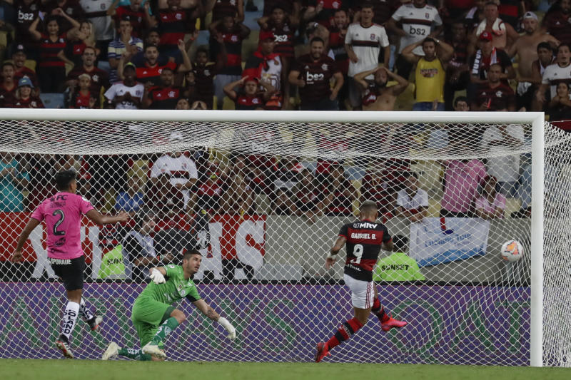 Gabriel Barbosa of Brazil's Flamengo scores the opening goal against Ecuador's Independiente del Valle during the final match of the Recopa at the Maracana stadium in Rio de Janeiro, Brazil, Wednesday, Feb. 26, 2020. (AP Photo/Leo Correa)