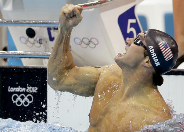 United States' Nathan Adrian celebrates his gold medal win in the men's 100-meter freestyle swimming final at the Aquatics Centre in the Olympic Park during the 2012 Summer Olympics in London, Wednesday, Aug. 1, 2012. (AP Photo/Matt Slocum)