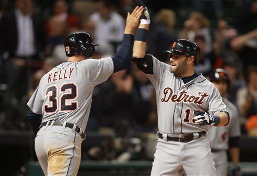 Detroit Tigers Alex Avila (13) is congratulated by teammate Don Kelly (32) after Avila hit a two-run home run during the 9th inning of a baseball game against the Houston Astros Friday, May 3, 2013, in Houston. (AP Photo/Patric Schneider)