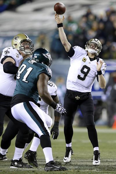 New Orleans Saints' Drew Brees (9) passes during the first half of an NFL wild-card playoff football game against the Philadelphia Eagles, Saturday, Jan. 4, 2014, in Philadelphia. (AP Photo/Michael Perez)