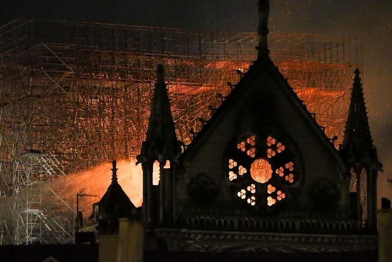 Flames and smoke are seen billowing from the roof at Notre Dame Cathedral in Paris (Picture: Getty)