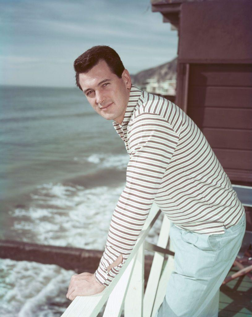 <p>Here, Hudson is pictured taking a break from his Hollywood hustle on the deck of his Malibu beach house.</p>