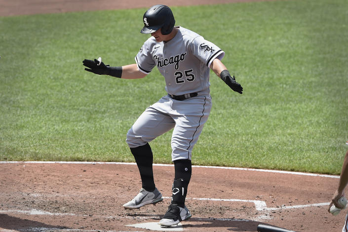 Chicago White Sox's Andrew Vaughn steps on the plate after hitting a three-run home run against the Baltimore Orioles In the sixth inning of a baseball game, July 11, 2021 in Baltimore.(AP Photo/Gail Burton)