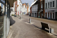 A street is deserted in the city center of Flensburg, Germany, Saturday, Feb. 20, 2021. Because of the high number of coronavirus infections in this northern German area, strickt measures take place in the city to avoid the further spread of the virus, including a curfew during the night from 21.00 in the evening until 5:00 in the morning. (Frank Molter/dpa via AP)