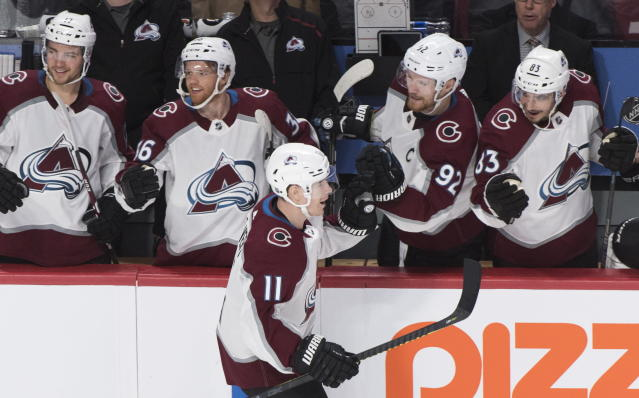 Colorado Avalanche's Matt Calvert (11) celebrates with teammates after scoring against the Montreal Canadiens during the second period of an NHL hockey game Thursday, Dec. 5, 2019, in Montreal. (Graham Hughes/The Canadian Press via AP)