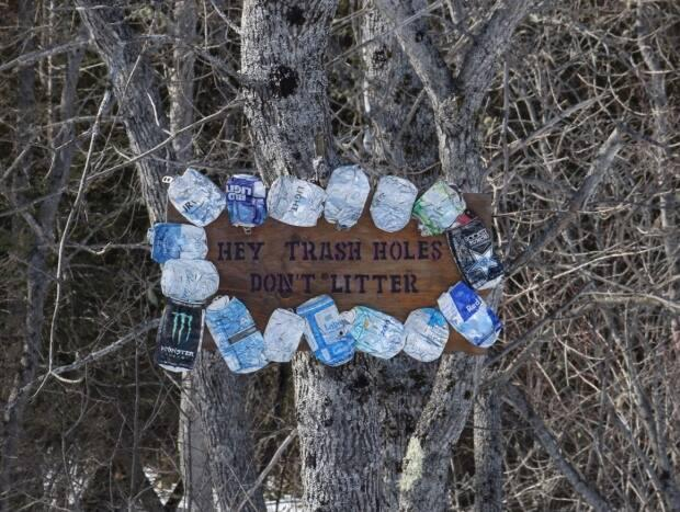 One of several signs on the island asking people not to litter.