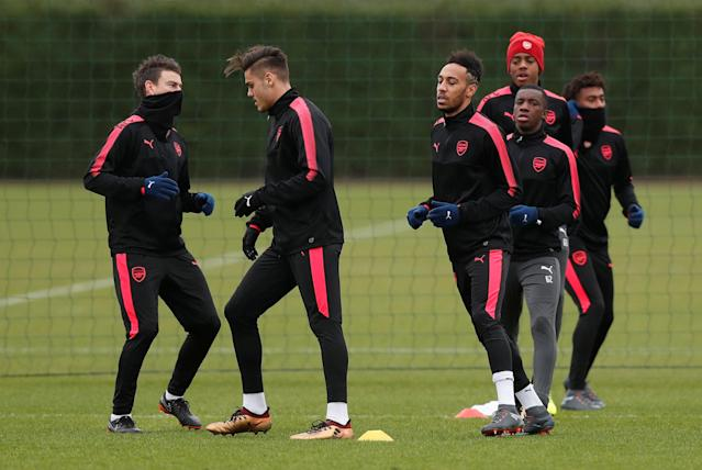Soccer Football - Europa League - Arsenal Training - Arsenal Training Centre, St Albans, Britain - February 14, 2018 Arsenal's Pierre-Emerick Aubameyang, Laurent Koscielny and team mates during training Action Images via Reuters/Peter Cziborra