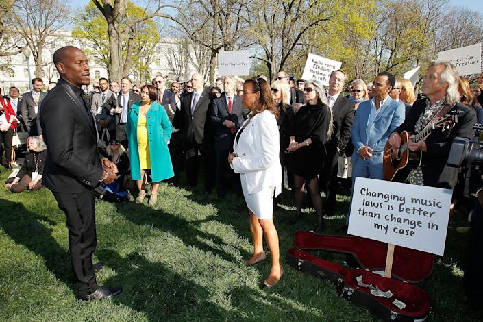 Singer, songwriter, actor and author Tyrese Gibson (left) and Kathy Sledge (center) of Sister Sledge lead participants of GRAMMYs on the Hill Advocacy Day in a busking demonstration inUpper Senate Park on Capitol Hill on April 14, 2016. (Photo by Paul Morigi/WireImage for The Recording Academy)
