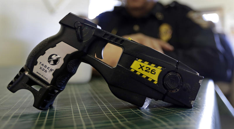 """FILE - This Nov. 14, 2013, file photo, shows a Taser X26 on display. Shares in Axon Enterprises, the maker of Taser stun guns, have fallen more than 6 percent after the company admitted it had not replied to Securities and Exchange Commission inquiries due to """"miscommunication issues."""" In a filing with the SEC on Thursday, Oct. 19, 2017, Axon said it had just become aware of the inquiries from the agency and was working to resolve the matter. (AP Photo/Michael Conroy, File)"""