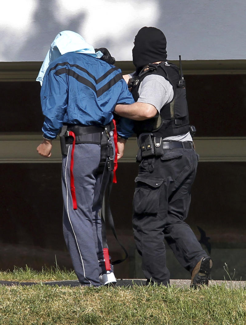"An alleged al-Qaida  member, left, is brought to a building of the federal court in Karlsruhe, Germany, Saturday, April 30, 2011. German officials say three suspected al-Qaida members were working on making a shrapnel-laden bomb they could use in an attack on a crowded area such as a bus or bus stop when they were arrested Friday. The attack was ""still in the experimentation stage,"" said anti-terrorism prosecutor Rainer Griesbaum in a news conference Saturday. (AP Photo/dapd, Daniel Kopatsch)  SWITZERLAND, AUSTRIA AND GERMANY OUT"
