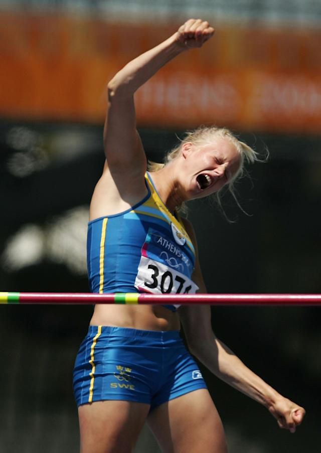 ATHENS - AUGUST 20: Carolina Kluft of Sweden celebrates after she jumped in the high jump discipline of the women's heptathlon on August 20, 2004 during the Athens 2004 Summer Olympic Games at the Olympic Stadium in the Sports Complex in Athens, Greece. (Photo by Andy Lyons/Getty Images)