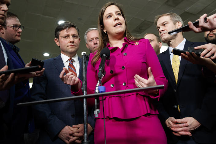 FILE - In this Jan. 23, 2020, file photo Rep. Elise Stefanik, R-N.Y., center, accompanied by from left, Rep. Mike Johnson, R-La., Rep. Mark Meadows, R-N.C., Rep. Lee Zeldin, R-N.Y. and Rep. Jim Jordan, R-Ohio, speaks to the media before the impeachment trial of President Donald Trump on Capitol Hill in Washington. Conservatives in and out of Congress are expressing opposition to Stefanik's rise toward House Republicans' No. 3 leadership job. House Republicans plan to meet privately next week, and seem certain to oust Rep. Liz Cheney, R-Wyo., from that top post. (AP Photo/ Jacquelyn Martin, File)