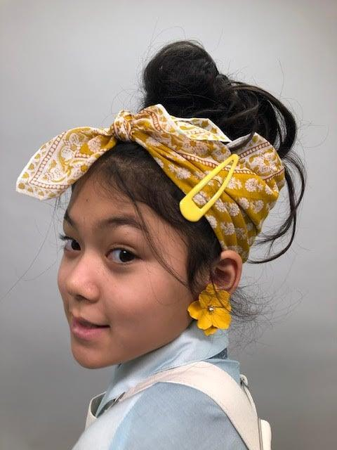 """<p>""""She was one character that was really, obviously, worked on from top to bottom. In every fitting photo, we put her hair up, we've done the earrings and scrunchies and the barrettes and all the rings, the jewelry. We adorned her more than anyone else.""""</p>"""