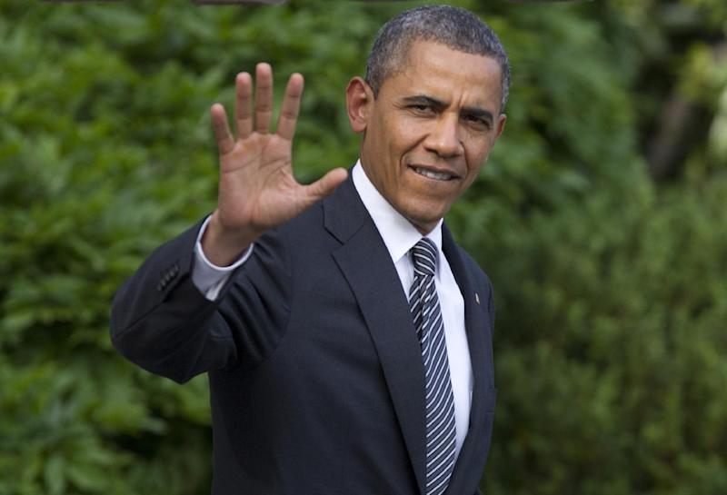 President Barack Obama waves as he walks from the White House in Washington, Friday, May 18, 2012,  to board Marine One, as he travels to Camp David for the G8 Summit. (AP Photo/Carolyn Kaster)